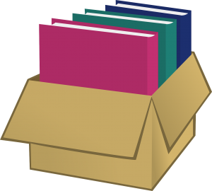 a pink, a green and a blue book in a box