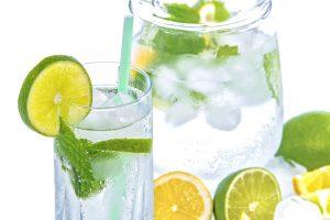 a glass and a jug of lemonade