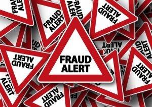 """sings that say """"Fraud Alert"""""""