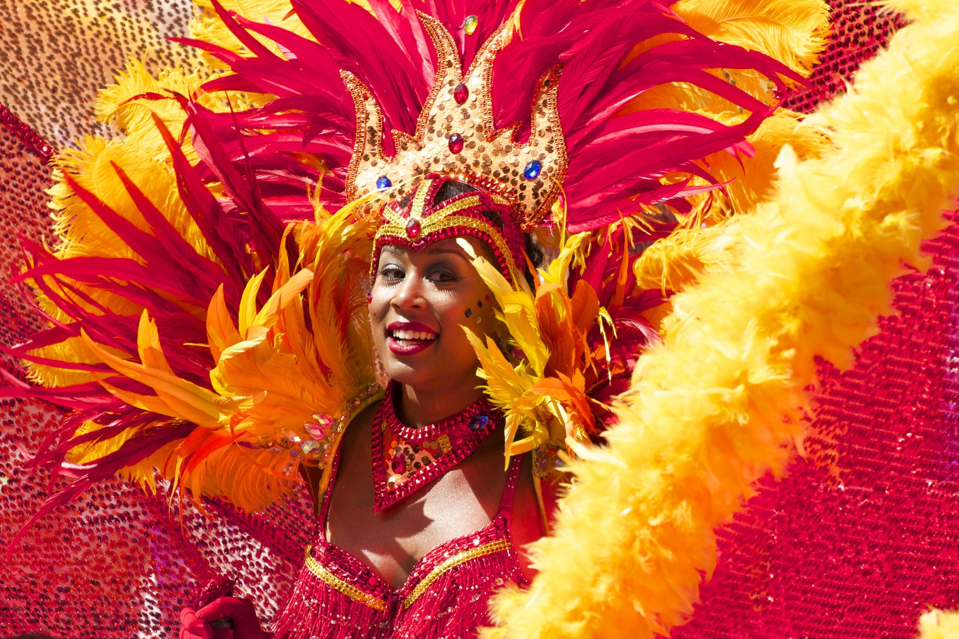 A woman in a red and yellow carnival costume.
