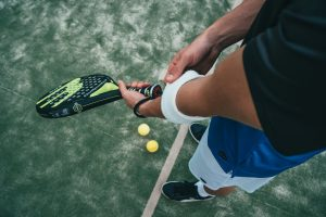 Tennis player's arm preparing to serve