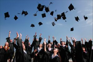 students throwing their hats in air in best school districts in New Jersey