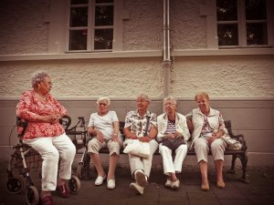 old ladies sitting on a bench