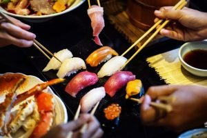 Friends eating japanese food