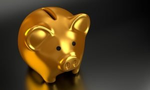A gold piggy bank to dig into when looking for cheap movers near me.