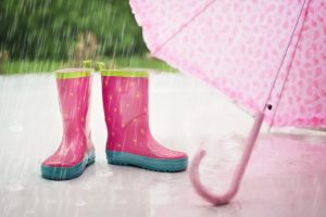Pink rain boots and pink umbrella that you need when you are moving in the fall