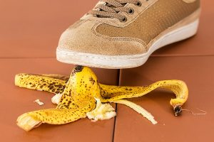 A person stepping on a banana peal