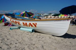 Boat named Cape May is on the beach