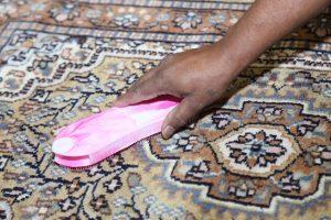 hand scrubbing a carpet