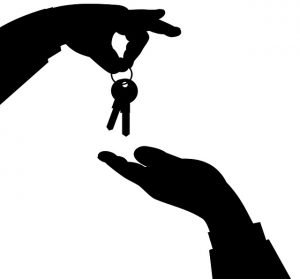 Hands handing the keys purchasing property abroad