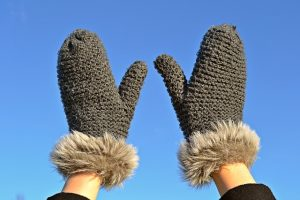 Grey gloves to keep you warm when moving in winter.