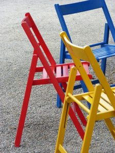 Different colored folding chairs and they save space when moving to a smaller house