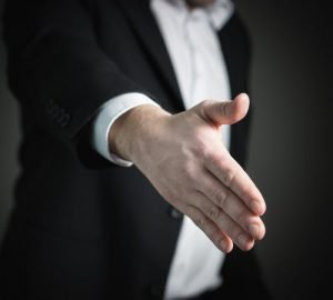 Businessman offering a hand
