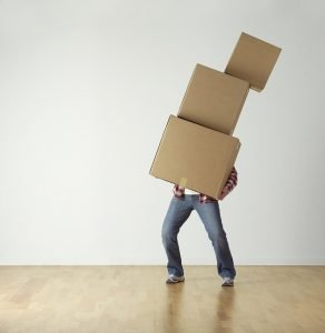 Man with heavy boxes - you can be like him in order to help your movers NJ