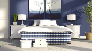 A bedroom featuring a blue and white art piece on the wall