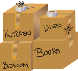 Boxes with the titles : Kitchen, Dishes, Bedroom and Books on them