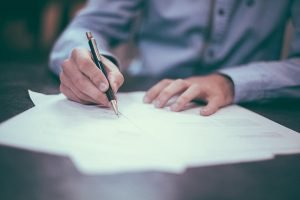Man write moving contracts and paperwork for your NJ moving