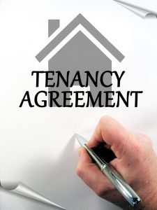 a hand signing agreement with landlord about Cheap rental decorating tips