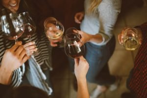 Friends toasting to finding top cities for singles in New Jersey