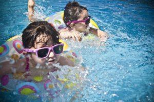 Two girls in a swimming pool Family fun in Bayonne NJ)