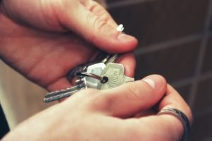 a man holding keys after his move to Bayonne NJ