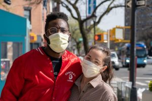 Two people wearing Covid-19 masks