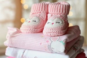 prepare baby clothes for moving with a baby