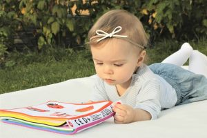 a baby reading a book