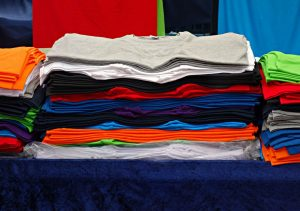 a pile of t-shirts in variant colours