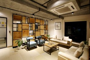 a living room filled with furniture making your consider if moving your furniture long-distance is worth it