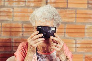 senior lady taking a photo