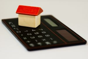 a house on a calculator as a moving budget you will need when Buying a second home in NJ