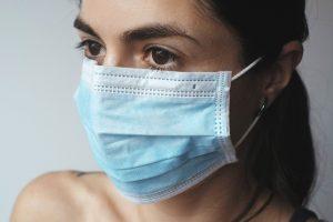 a woman wearing a mask