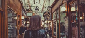 A girl strolling in a shopping passage