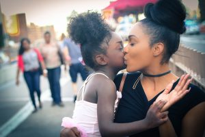 mother kissing her doughter