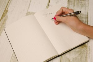 person writing a plan