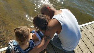 father and kids enjoying one of the New Jersey places for single parents