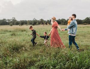 a family walking through a field in Franklin Park as a depiction of where do young parents move to