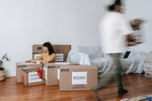 a couple packing one room for their relocation process