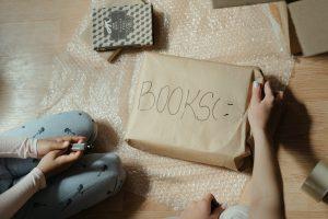 a person labeling box