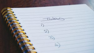 a notebook with a planner for today to learn when to start packing for a relocation