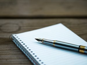 Pen and paper you will use to make a plan on packing for a local move in NJ