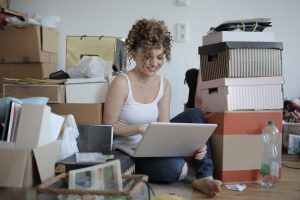 a woman taking a break from decluttering her home
