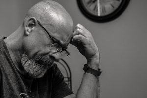 a black and white picture of a man thinking